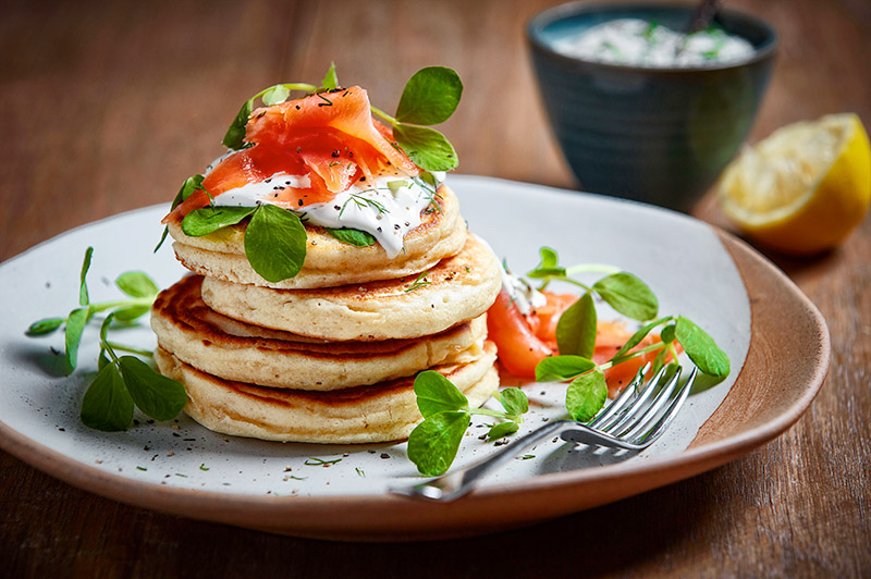Pancakes with pea shoots and smoked salmon