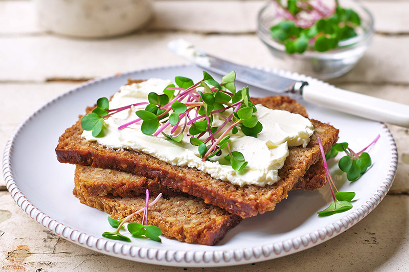 Cream Cheese and Pink Radish on Rye Bread