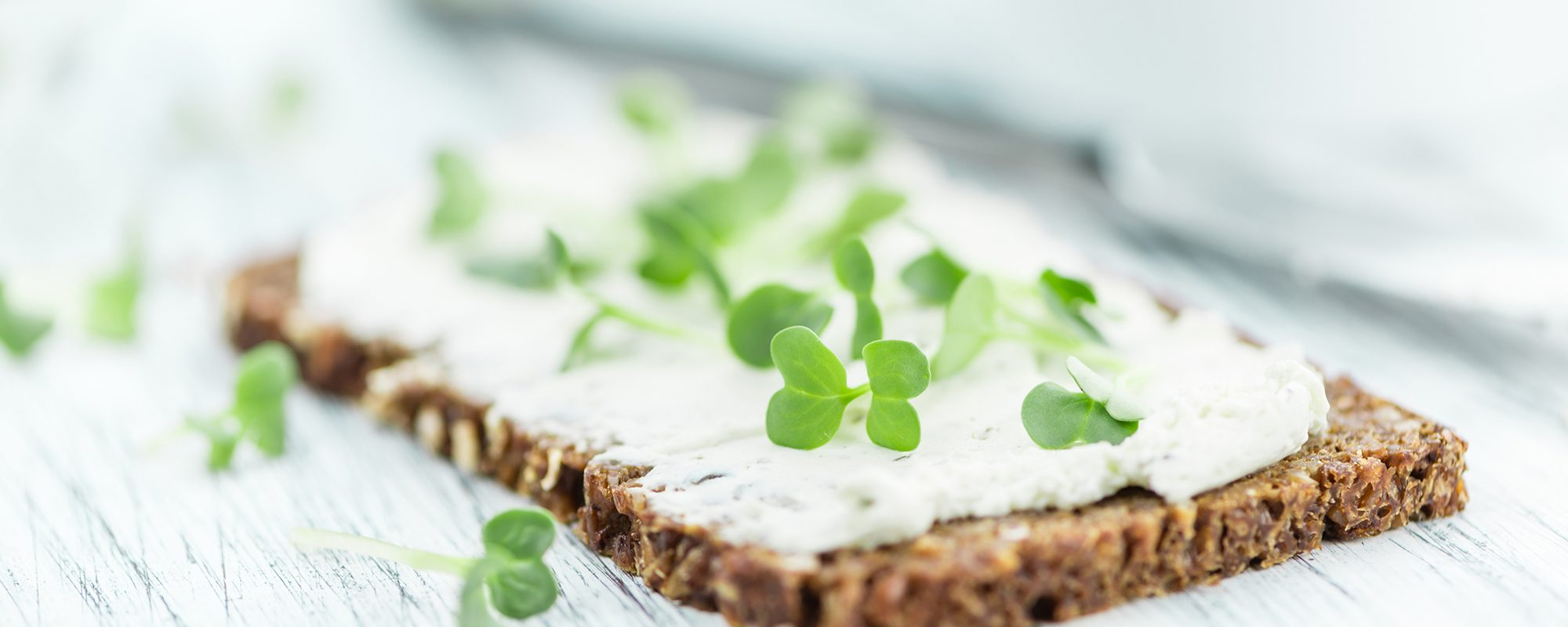 Salad cress with cream cheese on rye bread