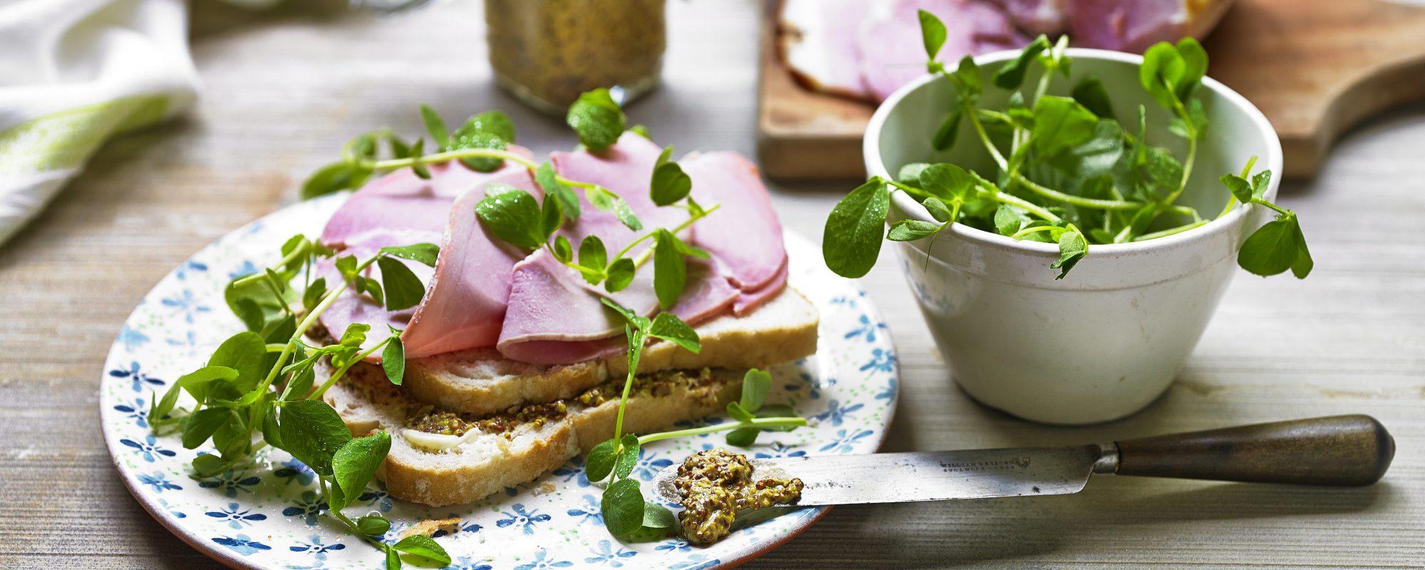 Ham, mustard and pea shoots sandwich